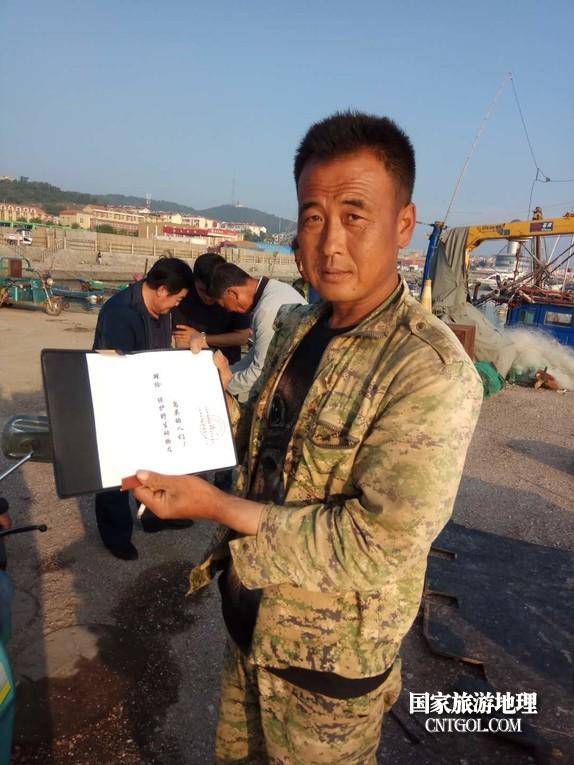 热心渔民梁中新