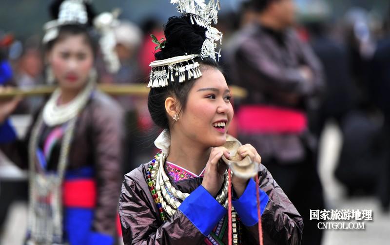 2018年12月5日,在2018注册开户送体验金平台省黔东南从江县贯洞镇五年一度的侗族鼓藏节上,几名侗族姑娘在节日里。--梁光源